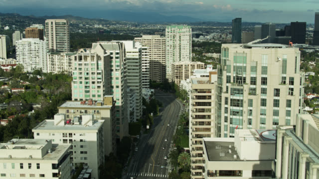 static aerial view of quiet wilshire boulevard - westwood neighborhood los angeles stock videos & royalty-free footage