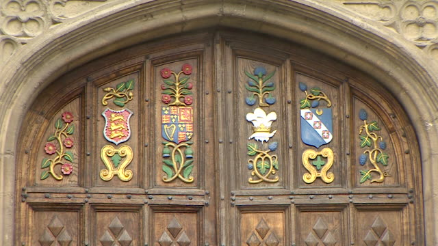 static close up shot of a decorative coat of arms adorning a grand wooden door at oriel college, oxford - 20 24 years stock videos & royalty-free footage