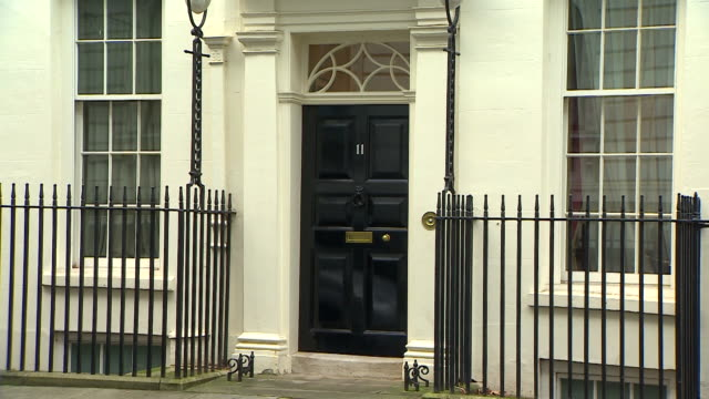 static close up shot of the front door of number 11, downing street - erkerfenster stock-videos und b-roll-filmmaterial