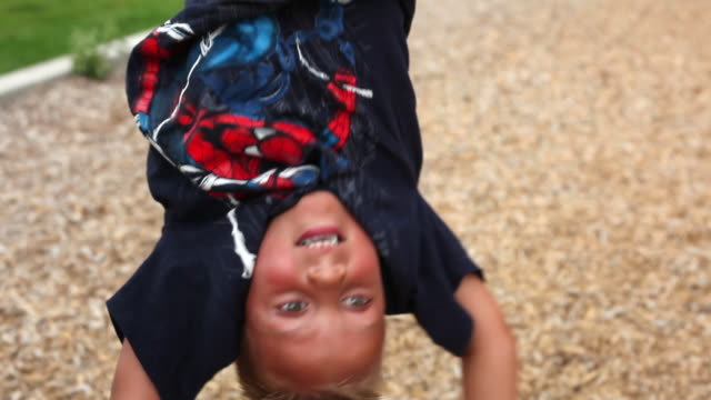 static closeup shot of an upside down boy. - upside down stock videos and b-roll footage