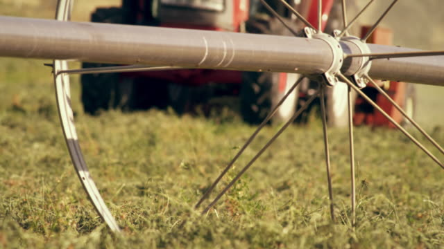 static close-up shot of wheel irrigation system - プロボ点の映像素材/bロール