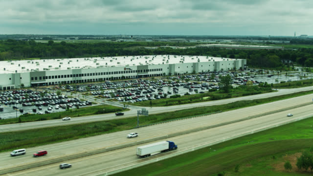 static drone shot of amazon fulfillment center in wisconsin - heavy goods vehicle stock videos & royalty-free footage