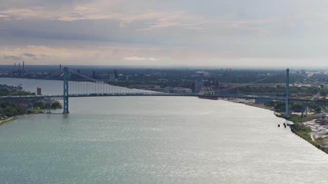 static drone shot of ambassador bridge between detroit, usa and windsor, canada - detroit michigan stock videos & royalty-free footage