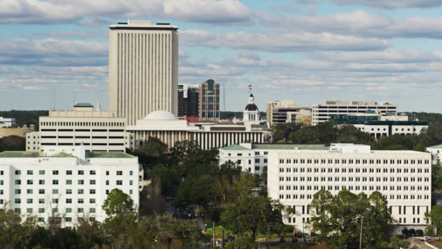 static drone shot of civic buildings around state capitol complex in tallahassee, florida - florida us state stock videos & royalty-free footage