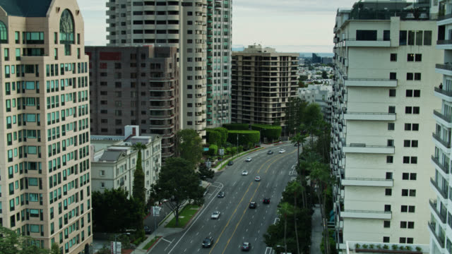 static drone shot of condo canyon, wilshire blvd, los angeles - westwood neighborhood los angeles stock videos & royalty-free footage