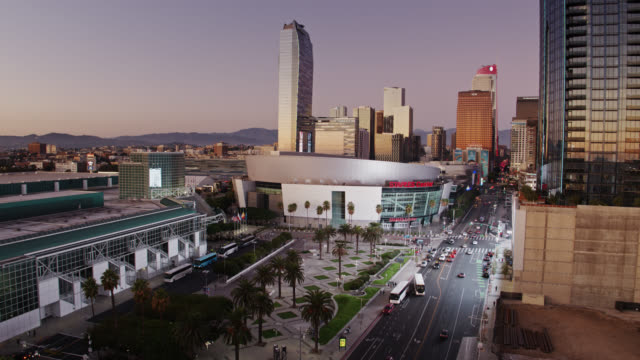 static drone shot of figueroa street looking towards los angeles convention center and staples center - microsoft theater los angeles stock videos & royalty-free footage