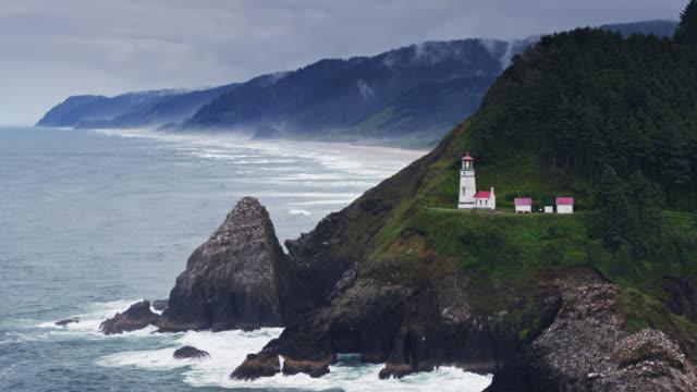 static drone shot of heceta head lighthouse - heceta head stock videos & royalty-free footage
