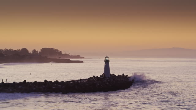 static drone shot of lighthouse in santa cruz at sunrise - santa cruz california stock videos and b-roll footage