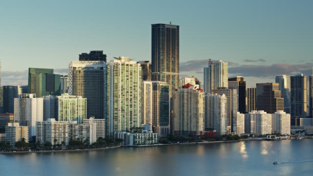 static drone shot of miami condo towers overlooking biscayne bay - biscayne bay stock videos & royalty-free footage