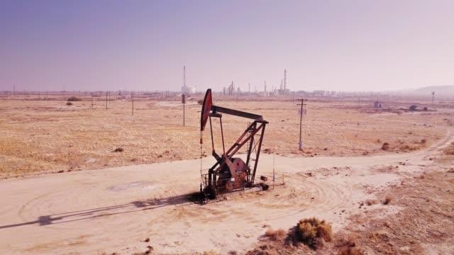 static drone shot of pumpjack in kern county oil field - pump jack stock videos & royalty-free footage