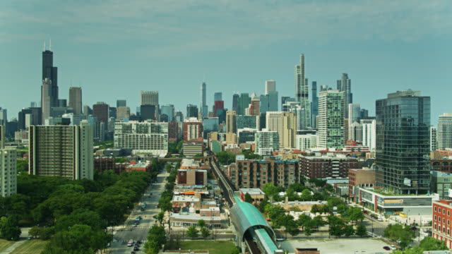 static drone shot of south loop and downtown chicago - chicago 'l' stock videos & royalty-free footage
