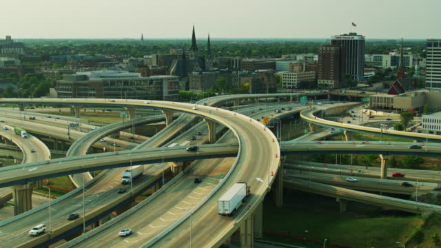 static drone shot of the marquette freeway interchange in milwaukee - complexity stock videos & royalty-free footage