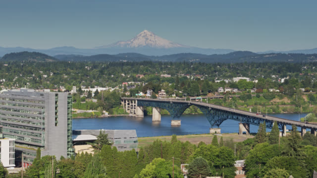 static drone shot of the ross island bridge with mt hood in background - portland oregon stock videos & royalty-free footage