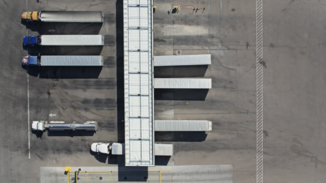 static drone shot of truck stop - articulated lorry stock videos & royalty-free footage