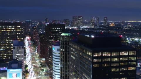 static drone shot of wilshire blvd, los angeles at night - westwood neighborhood los angeles stock videos & royalty-free footage