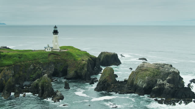 static drone shot of yaquina head lighthouse - oregon coast stock videos & royalty-free footage