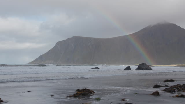 static establishing shot of a rainbow at a beach in norway on september 30 2018 - music or celebrities or fashion or film industry or film premiere or youth culture or novelty item or vacations bildbanksvideor och videomaterial från bakom kulisserna