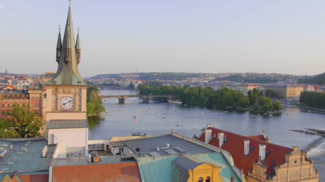 static establishing shot of colorful rooftops and architecture and the vltava river in old town prague czech republic - establishing shot stock videos & royalty-free footage