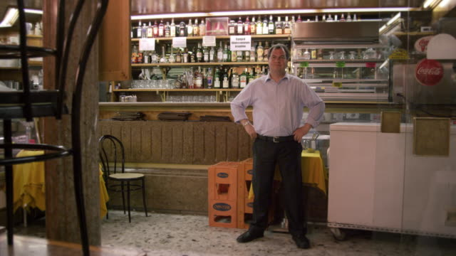 static full shot of a man standing in front of the bar at an italian cafe. - geschäftsinhaber stock-videos und b-roll-filmmaterial