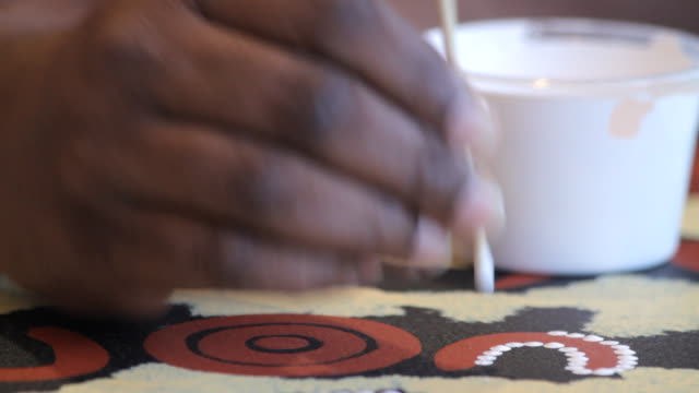 cu static hand applying paint to aboriginal tiwi art / northern territory, australia - minority groups stock videos & royalty-free footage