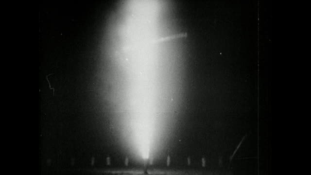 static low angle view of a massive wooden cross being burnt at night during a klu klux klan meeting. small figures of klansmen dressed in white form... - ku klux klan stock videos & royalty-free footage