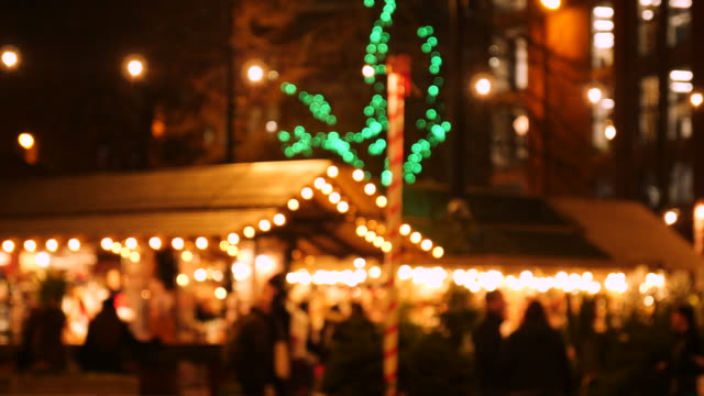 static out of focus shot of a mulled wine stall the manchester christmas market in albert square at night - christmas market stock videos & royalty-free footage