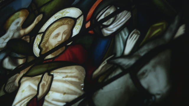 static sequence showing a wide shot and close-up of jesus christ riding a donkey, surrounded by bowing figures at a church in england, uk. - begriffssymbol stock-videos und b-roll-filmmaterial
