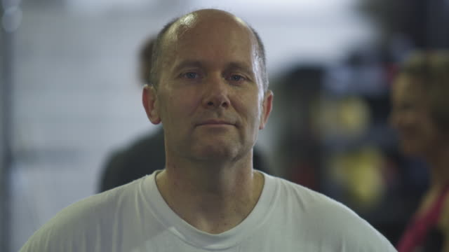 Static shot of a balding middle-aged man