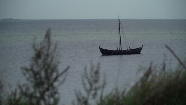 static shot of a boat floating on the water in trelleborg sweden - oresund region stock videos & royalty-free footage