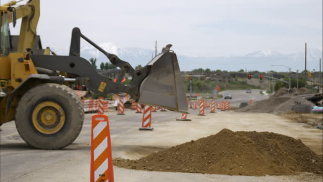 static shot of a bulldozer at at a construction site. - bulldozer stock videos and b-roll footage