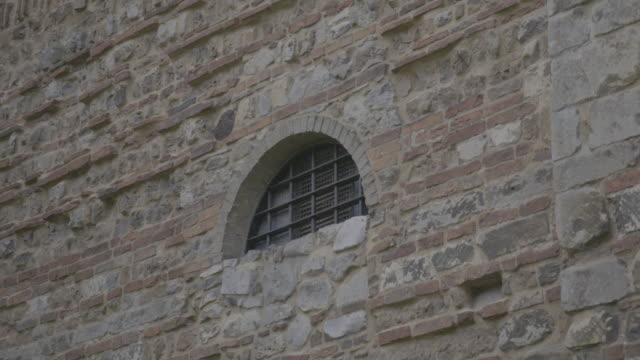 static shot of a cell window on the east front of the colchester castle - circa 12th century stock videos & royalty-free footage
