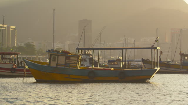 static shot of a lone boat floating in guanabara bay. - 2013 stock-videos und b-roll-filmmaterial