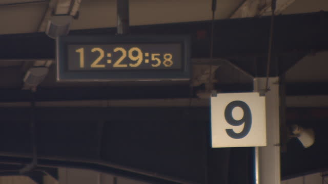 static shot of a platform number sign and a digital clock at york railway station, england - digital clock stock videos & royalty-free footage