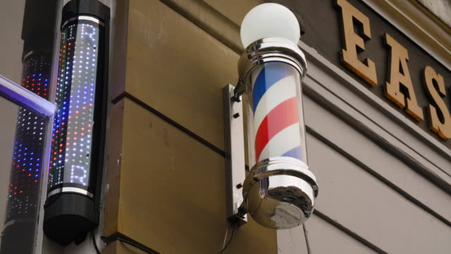 Static shot of a revolving barber's pole in the Northern Quarter, Manchester