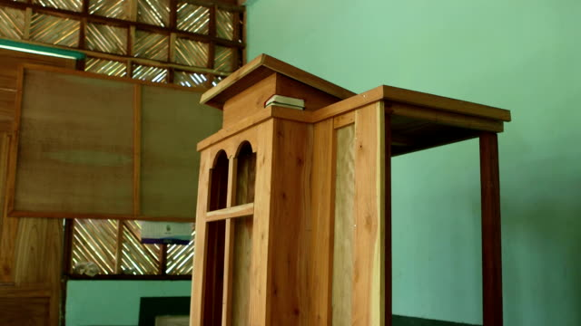 Static shot of a simple wooden pulpit