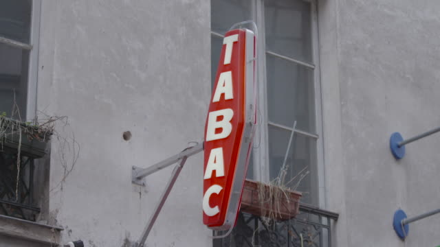 Static shot of a 'Tabac' sign outside a shop in Paris, France