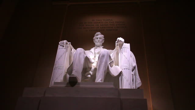 static shot of abraham lincoln statue at the lincoln memorial in washington dc at night - abraham lincoln stock videos & royalty-free footage