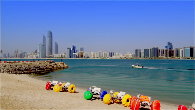 static shot of abu dhabi beachfront and cityscape. - tourism stock videos & royalty-free footage