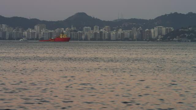 vídeos y material grabado en eventos de stock de static shot of an evening view of the rio coastline. - 2013