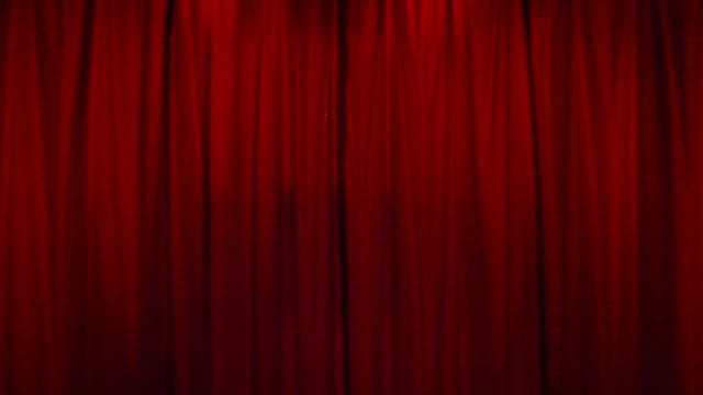 vidéos et rushes de static shot of an illuminated red velvet curtain in a cabaret club in paris, france - red