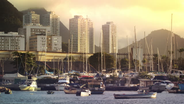 a static shot of boats docked at marina da gloria in rio de janeiro at evening,åêbuilding backdrop. - 2013 stock videos & royalty-free footage