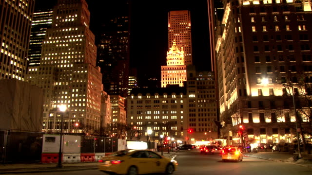 vidéos et rushes de static shot of buildings along central park south in grand army plaza lit up at night. - grand lit