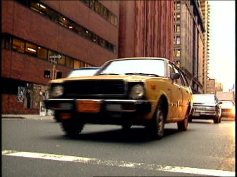 static shot of cars driving toward low angle camera on the street in new york city 1987 - 1987 stock videos & royalty-free footage