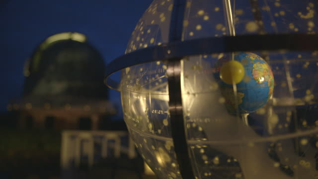 static shot of celestial globe outside an observatory - galaxy stock videos & royalty-free footage