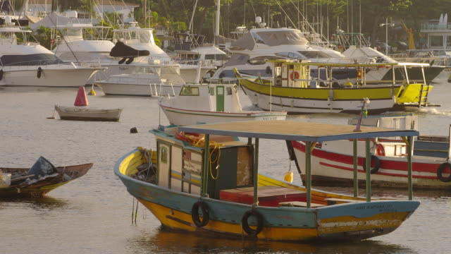 Static shot of colorful boats bobbing in a Rio port.