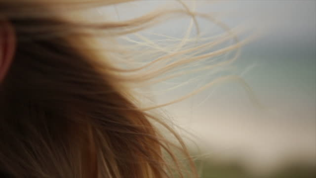 Static shot of female surfer's hair