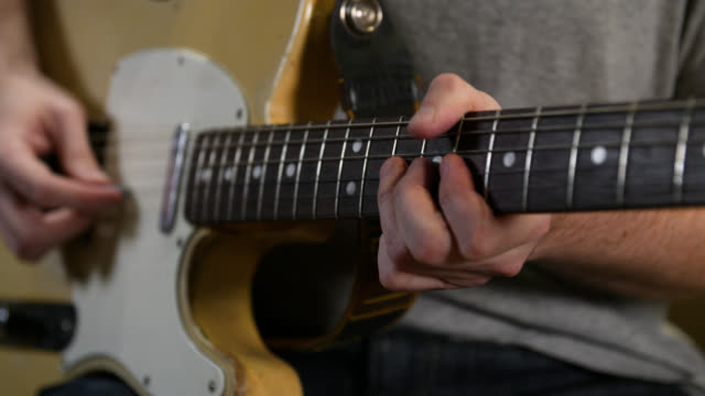 static shot of fingers riffing on an electric guitar fretboard - fretboard stock videos & royalty-free footage