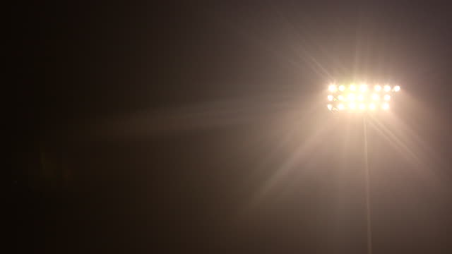 static shot of floodlight to the right of frame at bethpage ballpark, ny - floodlight stock videos & royalty-free footage