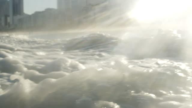 static shot of foamy waves. - gezeiten stock-videos und b-roll-filmmaterial