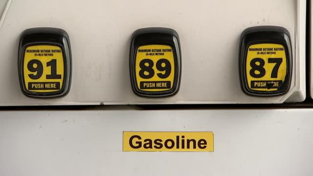 vídeos de stock e filmes b-roll de static shot of gasoline octane ratings at a gas station pump on april 16, 2019. - gas station